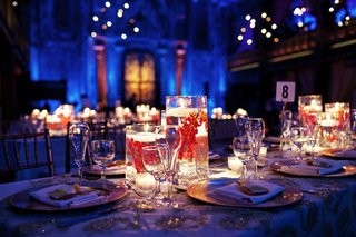 blue-reception-lighting-and-red-flower-in-floating-candle-centerpiece