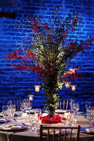 exposed-brick-wall-with-blue-lighting-and-willow-centerpiece