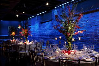 blue-reception-lighting-with-tree-centerpieces-and-candles