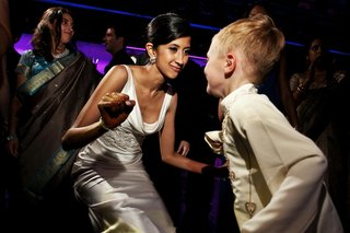 bride-dancing-with-ring-bearer-in-indian-wedding-outfit