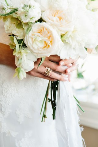 white-garden-rose-bouquet-being-held-by-bride-in-vintage-inspired-gold-engagement-ring