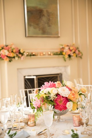 wedding-reception-table-low-centerpiece-footed-vase-with-pink-white-yellow-orange-flowers-candles