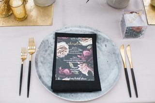 bridal-shower-with-grey-charger-plate-designed-to-look-like-concrete-gold-flatware-black-handles