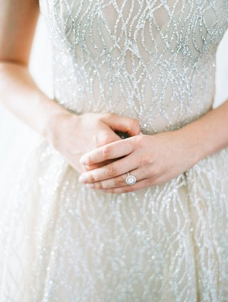 bride-in-sparkling-sequin-lazaro-wedding-dress-with-double-halo-engagement-ring-on-finger-wedding