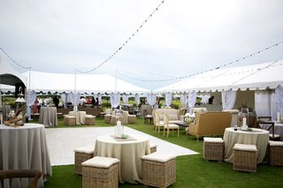 wedding-reception-lounge-space-dance-floor-alfresco-seaside-cloudy-wicker-champagne-colored-lights