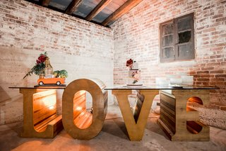 large-wooden-letters-spelling-love-with-glass-top-to-make-dessert-table