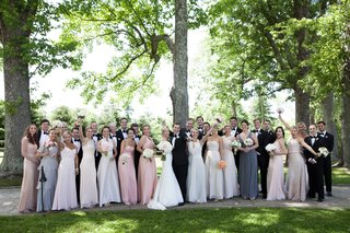 a-large-and-excited-bridal-party-standing-outside-before-the-ceremony