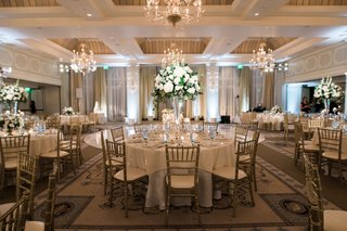 casa-del-mar-santa-monica-wedding-reception-gold-chiavari-chairs-tall-centerpiece-with-roses