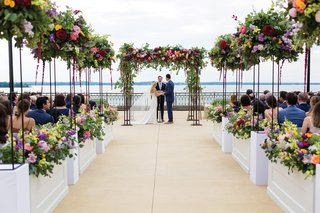 colorful-flowers-lining-a-wedding-ceremony-overlooking-lake-mendota