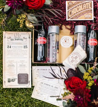 an-assortment-of-paper-goods-and-other-items-for-a-couples-rustic-european-style-wedding