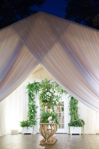 french-doors-decorated-with-greenery-white-flowers-at-entrance-to-tent-reception-venue-drapery