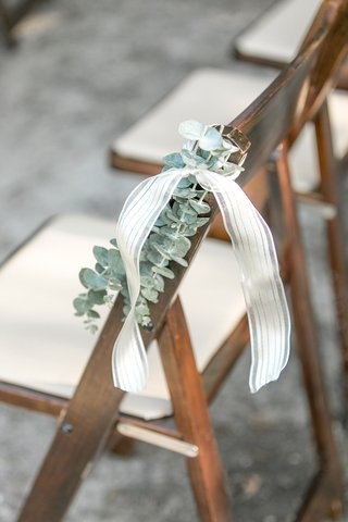 wood-ceremony-chair-wedding-with-eucalyptus-greenery-and-ribbon-chair