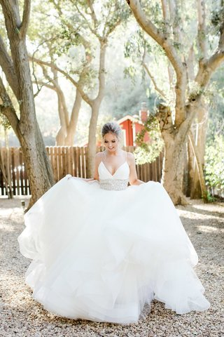 bride-in-lazaro-ball-gown-with-crystal-adorned-waist-and-spaghetti-straps