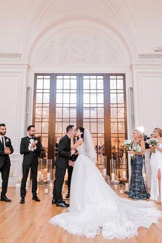 wedding-ceremony-bride-groom-kiss-los-angeles-ballroom-candles-decor
