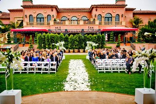 petal-covered-aisle-with-the-grand-del-mar-as-backdrop