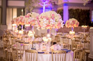 tall-centerpiece-with-pink-rose-white-orchid-white-hydrangea-flowers-gold-chairs-purple-lighting