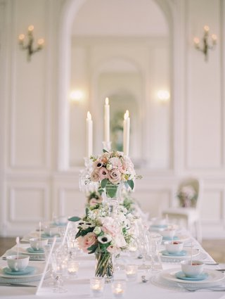 wedding-reception-table-with-votive-candles-and-pink-and-white-roses-lisianthus-white-anemones