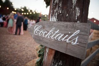 rustic-wood-cocktail-hour-sign-with-white-paint-calligraphy