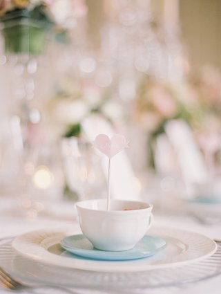 heart-shaped-place-card-propped-inside-a-teacup