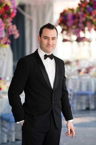 groom-in-a-black-tuxedo-at-country-club-wedding