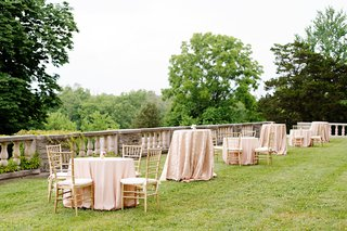 wedding-reception-cocktail-tables-on-grass-lawn-high-low-tables-pink-linens-gold-chairs-estate-lawn