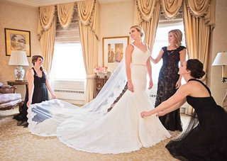 mother-of-the-bride-and-bridesmaids-help-bride-with-her-nelphi-veil-and-matthew-christopher-gown