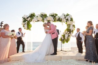 lucite-ceremony-arch-with-split-leaves-white-orchids-ivory-roses-green-hydrangeas