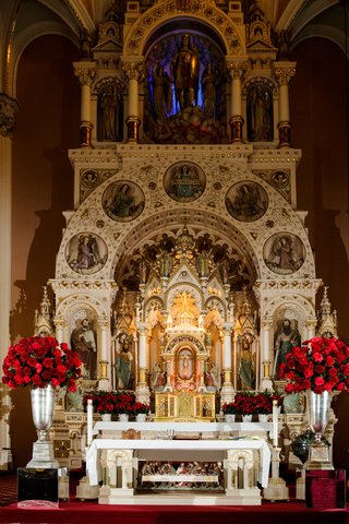 wedding-ceremony-beautiful-catholic-sanctuary-altar-red-roses-in-silver-urns-arrangements