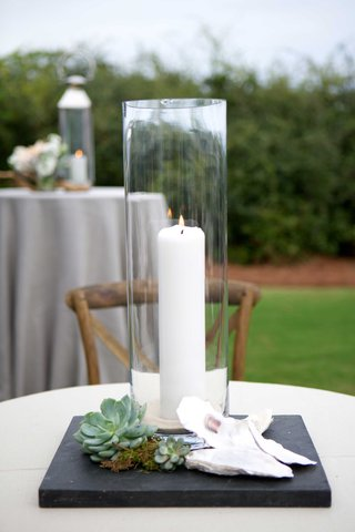 tall-glass-case-candle-white-succulents-greenery-shells-wooden-chair-reception-decor