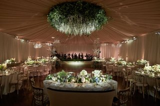wedding-reception-tented-walls-ceiling-drapery-flower-chandelier-dance-floor-live-band-greenery