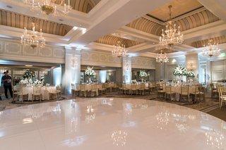 round-white-dance-floor-chandeliers-above-wedding-dance-floor