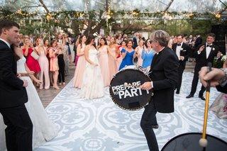 wedding-reception-dance-floor-tent-wedding-spanish-tile-motif-vinyl-prepare-to-party-drum-dancing
