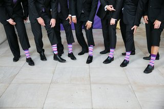 grooms-and-groomsmen-in-purple-blue-and-pink-striped-socks