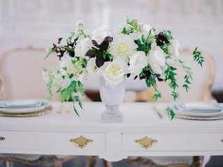 sweetheart-table-with-white-flowers-greenery-purple-leaves-in-an-urn-at-vibiana