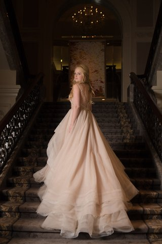 bride-on-staircase-in-chicago-wedding-venue-martina-liana-wedding-dress-blush-ivory-champagne-layers