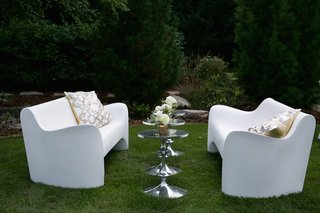 white-modern-sofas-with-silver-side-tables-and-pillows