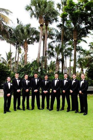 groomsmen-pose-waring-matching-black-tuxedos