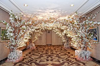 ritz-carlton-chicago-hallway-decorated-with-cherry-blossom-trees-white-orchids