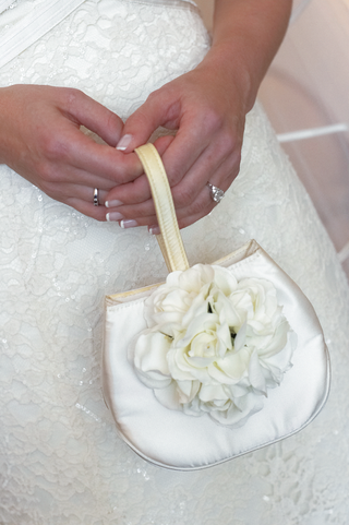 white-satin-bag-with-strap-and-flowers