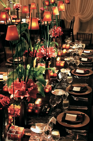 long-table-with-tall-centerpieces-and-lamps