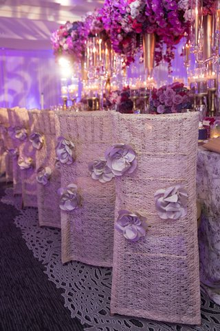 white-woven-chair-covers-3-d-flowers-bold-styled-shoot-wedding-feminine-details-pink-purple
