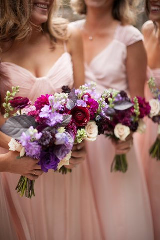 bridesmaids-holding-flowers-in-girly-colors