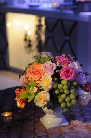 roses-orchids-and-grapes-in-white-vase