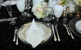 monogrammed-napkin-and-silver-rimmed-glassware