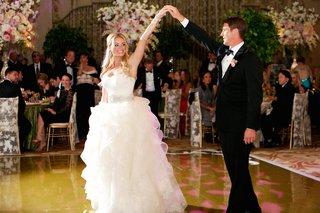 bride-and-groom-dancing-in-wedding-attire-at-reception