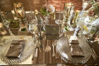 head-table-sign-on-mirror-table-with-cut-crystal-charger-plates-and-candle-votives