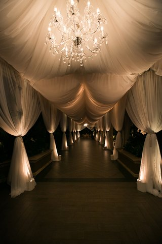 wedding-entryway-with-drapery-and-chandelier