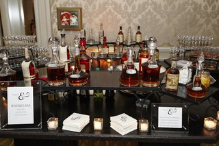 black-two-tiered-bartop-with-various-whiskey-bottles