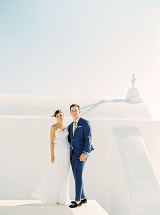 stephanie-economides-and-brandon-fay-destination-wedding-in-mykonos-greece-portrait-white-buildings