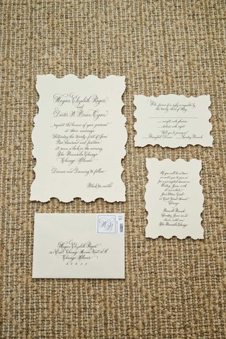 vintage-inspired-wedding-invitations-with-black-calligraphy-decorated-edges